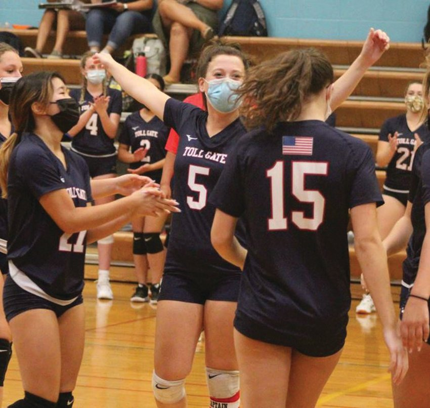 ON THE COURT: Toll Gate volleyball players, including  Cailin Tainsh (5) celebrate after scoring a point against  Johnston last week. The Panthers swept the Titans in three sets to claim the victory. Tainsh has been Toll Gate's top scorer to this point this season.