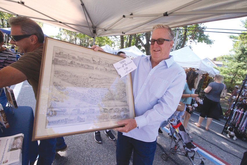 DELIGHTED BY THE FIND: Cranston Mayor Ken Hopkins found copies of an etching of Pawtuxet Village at the festival, which he plans to hang in City Hall. As he noted, before it was incorporated as a city, Cranston was known as Pawtuxet.