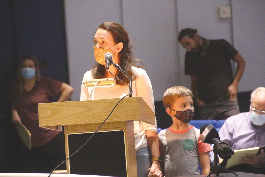 NEW TO WARWICK: Sarah Warren, who said the family recently moved to Warwick from Idaho, was anxious to learn when her son, Miles, who joined her at the podium, would be attending first grade in person.