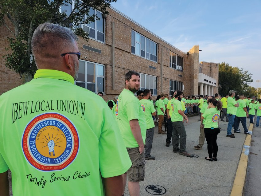 """The Rhode Island Building and Construction Trades Council (RIBCTC) also announced its support for the construction of the six-story, 3,864,972 square-foot """"new, state-of-the-art Amazon Robotics Sortable Fulfillment Center.""""    The organization — a federation of 16 local trade unions — swarmed into Wednesday night's meeting, wearing fluorescent T-shirts. Two trucks bedazzled by flashing electric signs were parked outside the Johnston High School."""