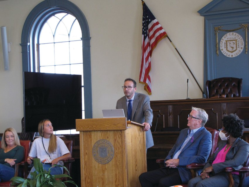 SHARING HIS STORY: Ward 6 Councilman Matthew Reilly speaks about his addiction and recovery during a Recovery Month event last week in City Hall's Council Chambers. Looking on, from left, are Tara Canavan, Megan Perry, Mayor Ken Hopkins and Ward 2 Councilwoman Aniece Germain.