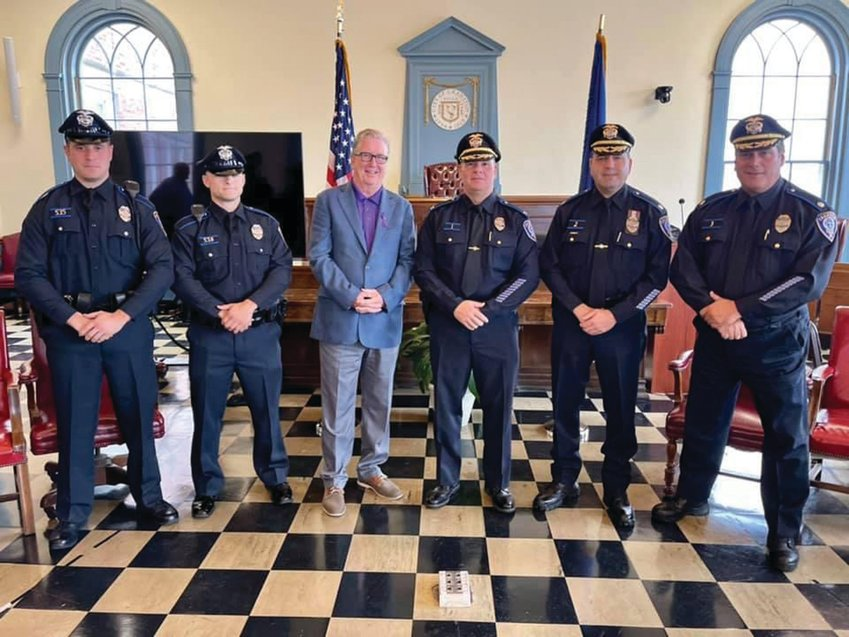 WELCOME TO CRANSTON: From left, Officer Michael Schiappa, Officer Michael Nolan, Mayor Ken Hopkins, Col. Michael Winquist, Maj. Todd Patalano and Maj. Robert Quirk gather during last week's swearing-in ceremony at City Hall.