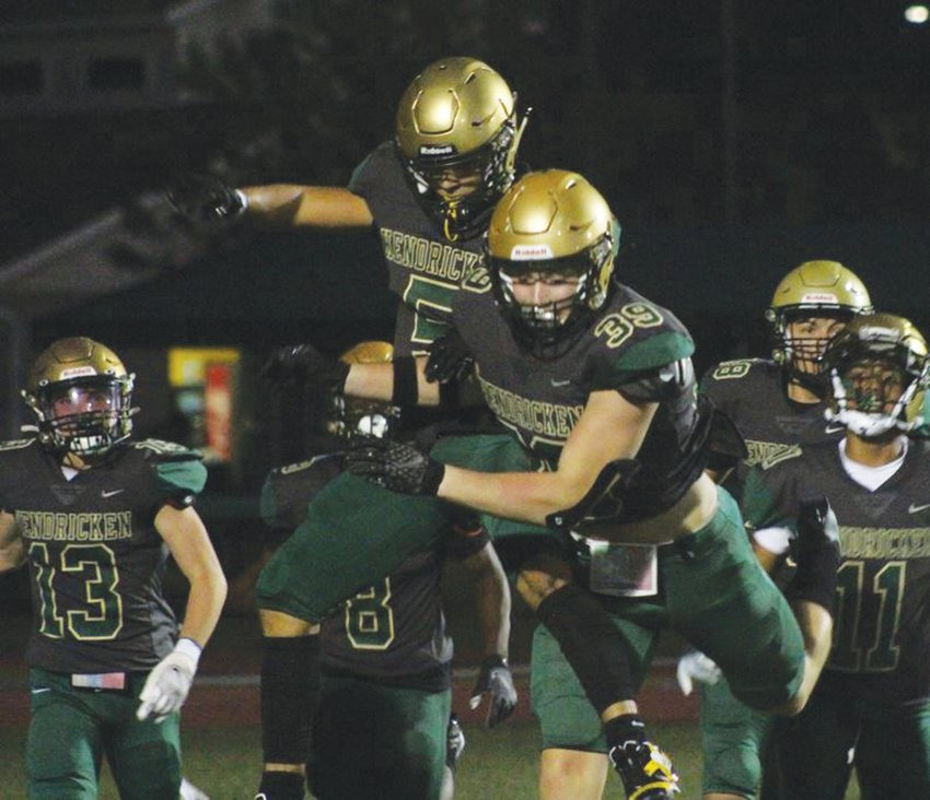 BOUNCING BACK: Members of the Hendricken football team celebrate after a score. (Photos by Alex Sponseller)