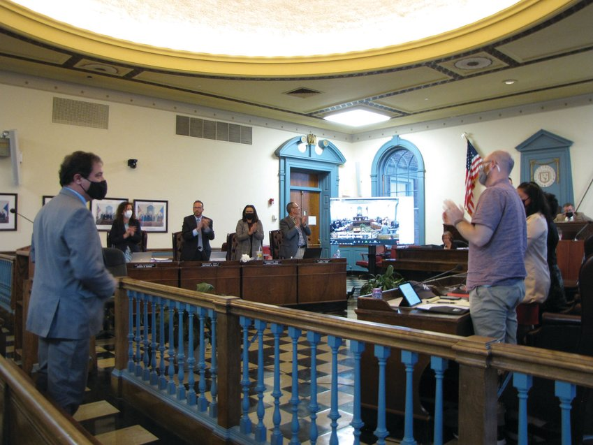 WELCOME ABOARD: Newly appointed Ward 4 Councilman Richard Campopiano receives a round of applause following the City Council's vote Monday in Council Chambers at City Hall.