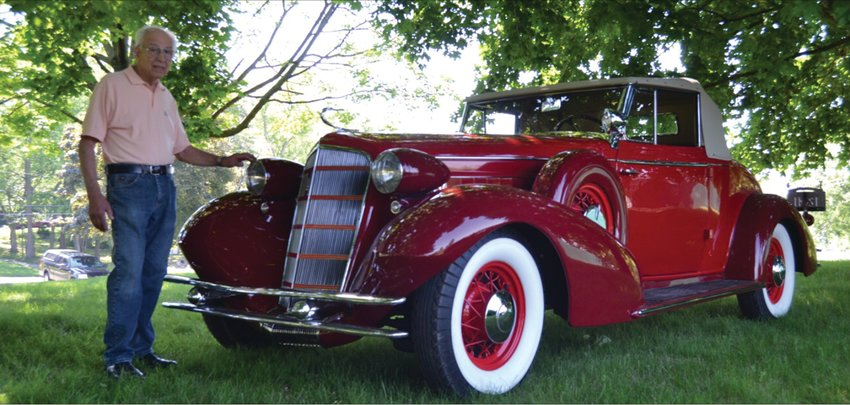 THE MAN AND HIS MACHINE: John Ricci poses for a photo with his fully restored 1934 Cadillac.