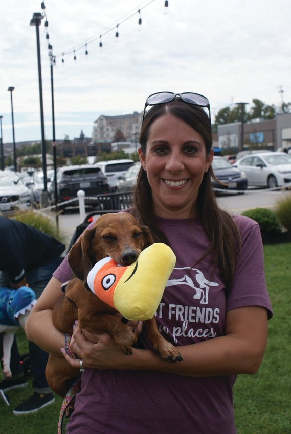 NEW MASCOT: Meet Garden City Center's new mascot, Louie, an 11-year-old Dachshund, pictured with his favorite chew toy and his mom, Regina Bifulco. His selection in the mascot contest was announced during the Yappy Hour.