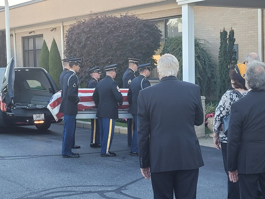 WITH HONORS: An American Airlines plane carrying the remains of U.S. Army First Lt. Anthony R. Mazzulla landed at T.F. Green International Airport in Warwick Tuesday afternoon. His flag-covered coffin was welcomed with honors, and transported to Nardolillo Funeral Home in Cranston via motorcade. In near-silence, a Rhode Island Army National Guard honor guard carried him through the door, past his surviving relatives, all born after he disappeared.