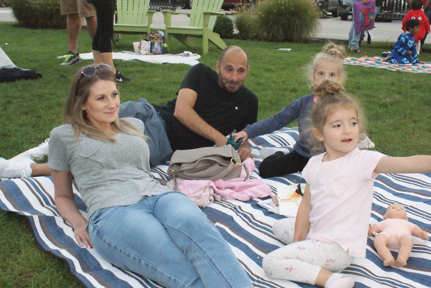 FAMILY FUN: The Moralet family made sure to bring a blanket to sit on during last week's Boo & View hosted by Garden City Center. Pictured with their parents, Gillian and Randy, are 4-year-old Reese and 6-year-old Sloane.