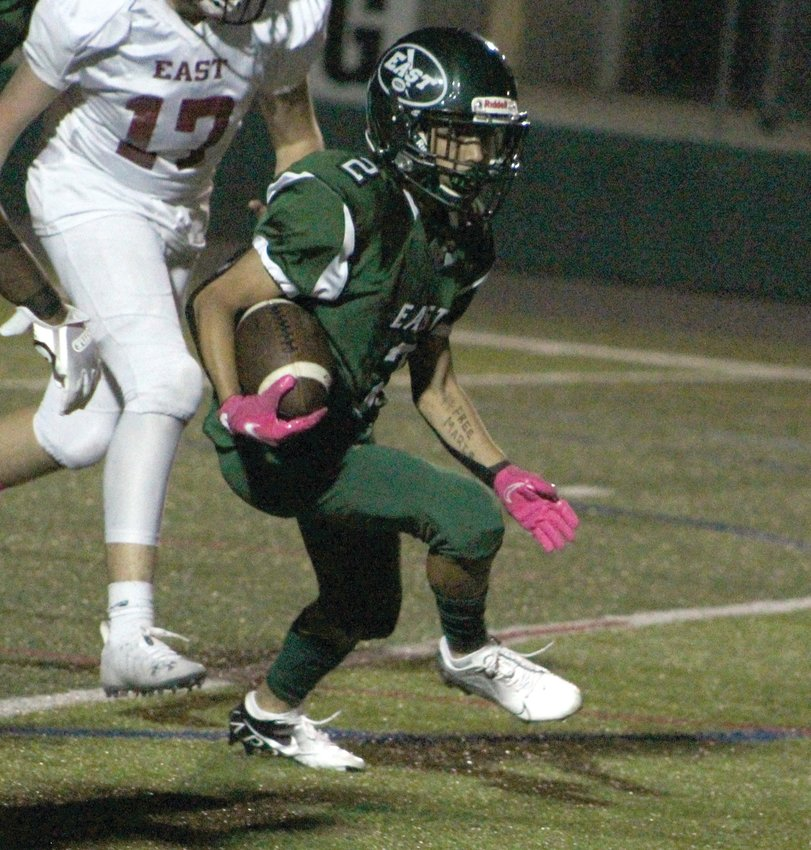 UP THE FIELD: Cranston East's Romeo Cordero  picks up some yards.