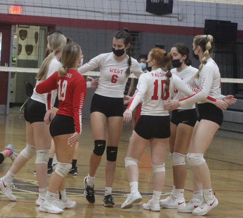 GETTING THE WIN: Members of the Cranston West girls volleyball team celebrate. (Photos by Alex Sponseller)