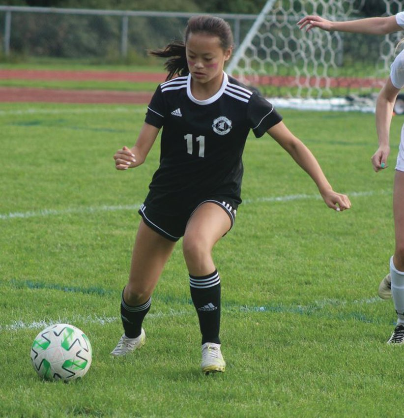 BACK ON TRACK: Pilgrim's Katie Ignagni dribbles the  ball up the field. (Photos by Alex Sponseller)