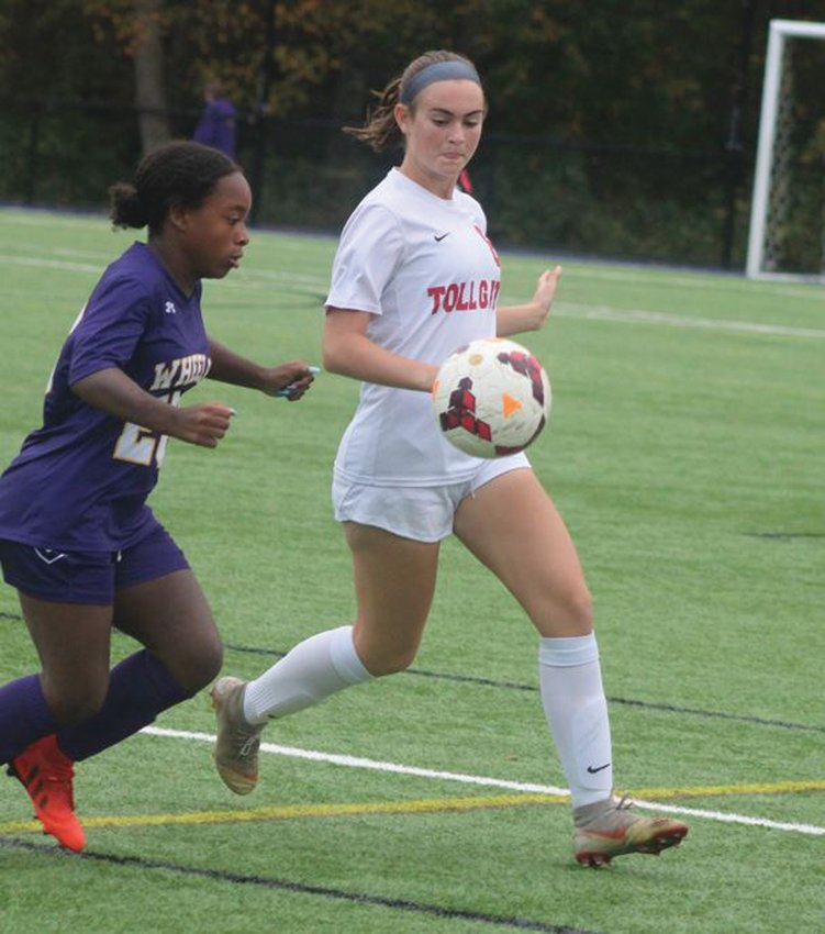 EYES ON THE PRIZE: Toll Gate midfielder Morgan Caianiello  battles a Wheeler player for possession last week. The Lady Titans have been on a roll as of late and have put themselves in position to make a playoff run after moving up to Division II this fall.