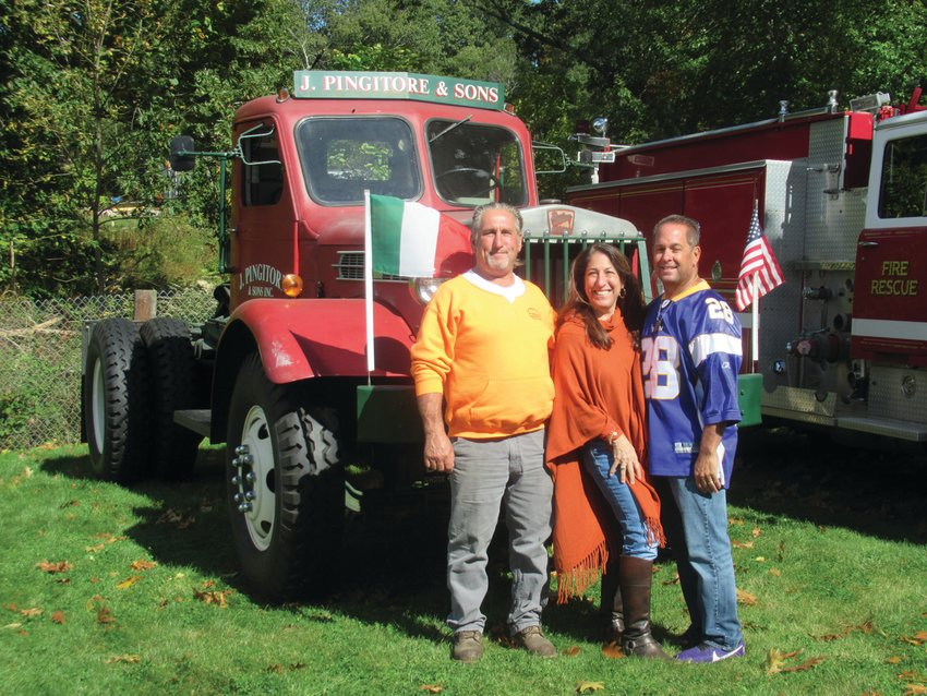 PREXY'S PALS: The Pingitores — siblings Joe, Fran, and Dave — enjoy Sunday's sparkling sun in front of the family owned 1942 Chain-Driven Sterling which was among the more than 60 vintage vehicles on display during Sunday's Ocean State Vintage Haulers Fall Round-up at Ron Rossi's Christmas Tree Farm in Cranston.