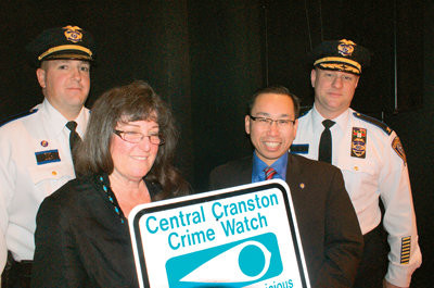 CUT THE CRIME: The Central Cranston Crime Watch received new signage Monday night to help decrease crime in the Auburn and Eden Park sections of the city. Pictured are District 1 Commander Lt. Stephen Antonucci, Diana Gordon of the Central Cranston Crime Watch, Mayor Allan Fung and Col. Marco Palombo, Chief of Police.