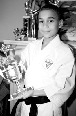 Eight-year-old karate champ wins big in national