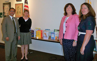 PARTNERS FOR A GOOD CAUSE: Mayor Allan Fung, Coordinator of Adult and Information Service for CPL Beth Johnson, Executive Director for Autism Project Joanne Quinn and R.I. Department of Health representative Deborah Garneau present the new collection of books on autism at the library.
