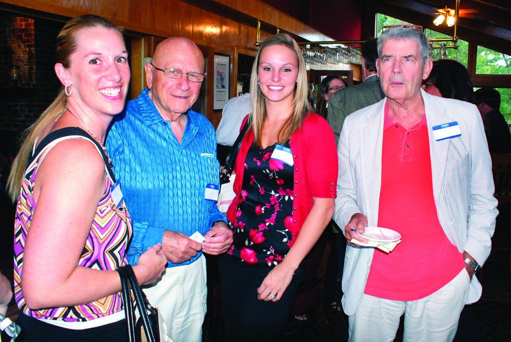 MAKING NEW CONTACTS: Enjoying the event are Summer Venagro of MICHE Bags, Leon Kayarian of Celebrity Car Museum, Stacie Venagro of MICHE Bags and Paul Schurr of Celebrity Classic Cars.