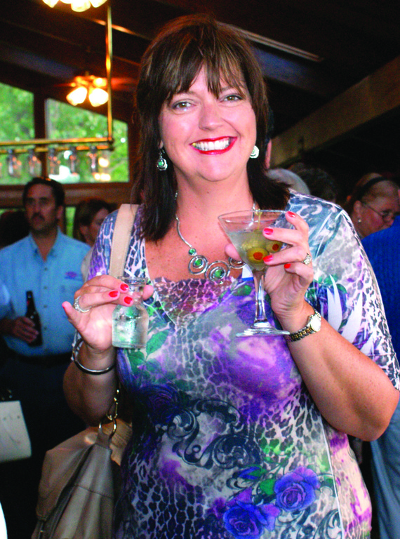 Ginny Shea of Mixed Media Promotions has a cocktail while meeting other business professionals. Shea provides media services to many Cranston businesses as well as throughout the region.