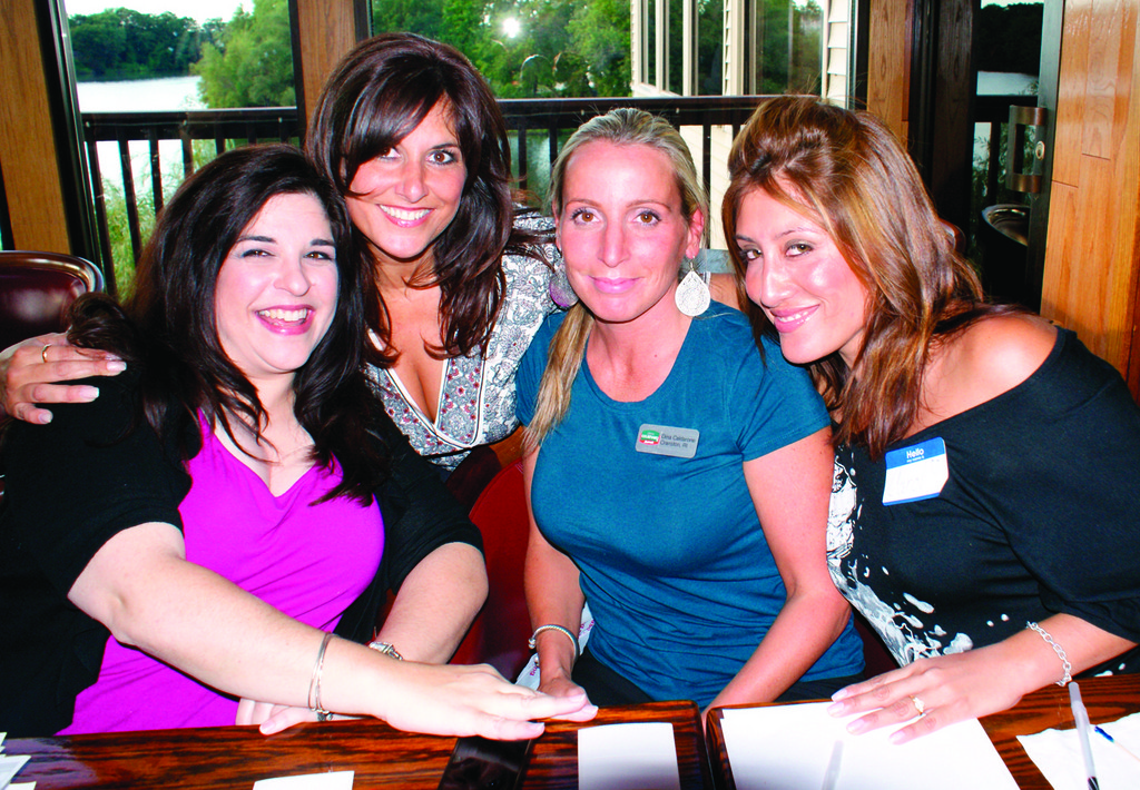ALL SMILES: Manning the registration table are Anna Maria Angelosanto, founder of Extraordinary Child; Pat Paolino, hostess for the evening and owner of Southern New England Woman Magazine; Dina Caldarone from Marriot Courtyard; and Carol Nenez of the Providence School Department.