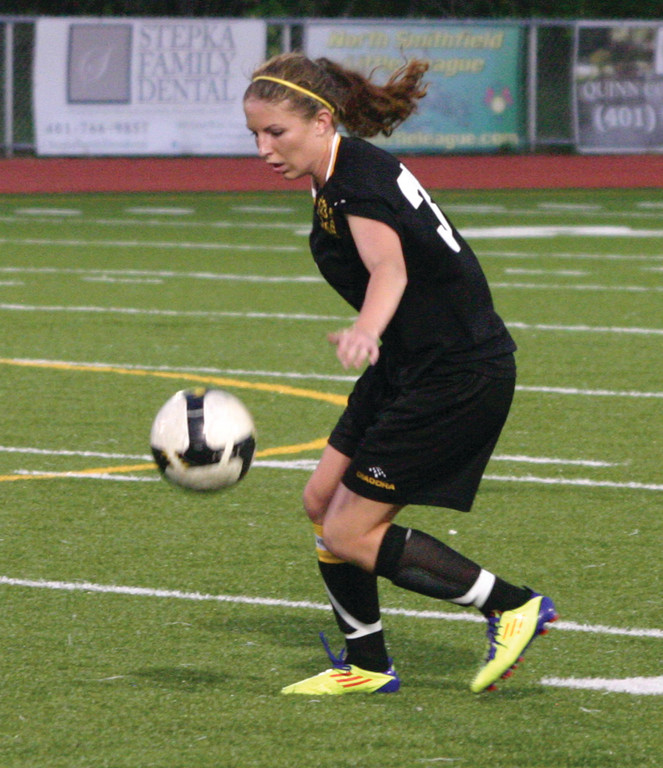 Heather Wolfenden tries to control the ball.