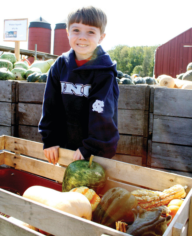 FALL FUN: Ian Foulds helps his grandparents pick out gourds at Dame Farm earlier this week.