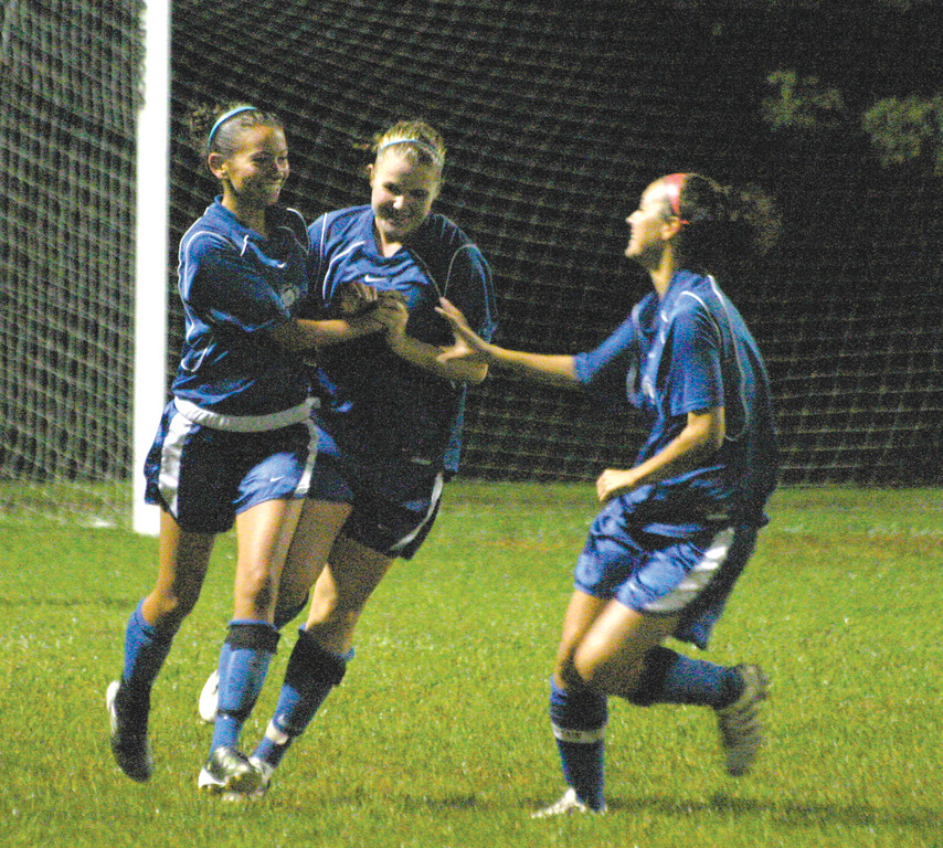 GOOD TIMES: Teammates celebrate with Larissa Paolantonio (left) after her goal in the 70th minute gave Vets a 1-0 lead over Toll Gate on Tuesday night. The 'Canes held on for the rivalry win.