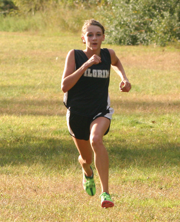 WINNING TIME: Pilgrim's Melanie Brunelle runs to first place in Monday's girls' race.