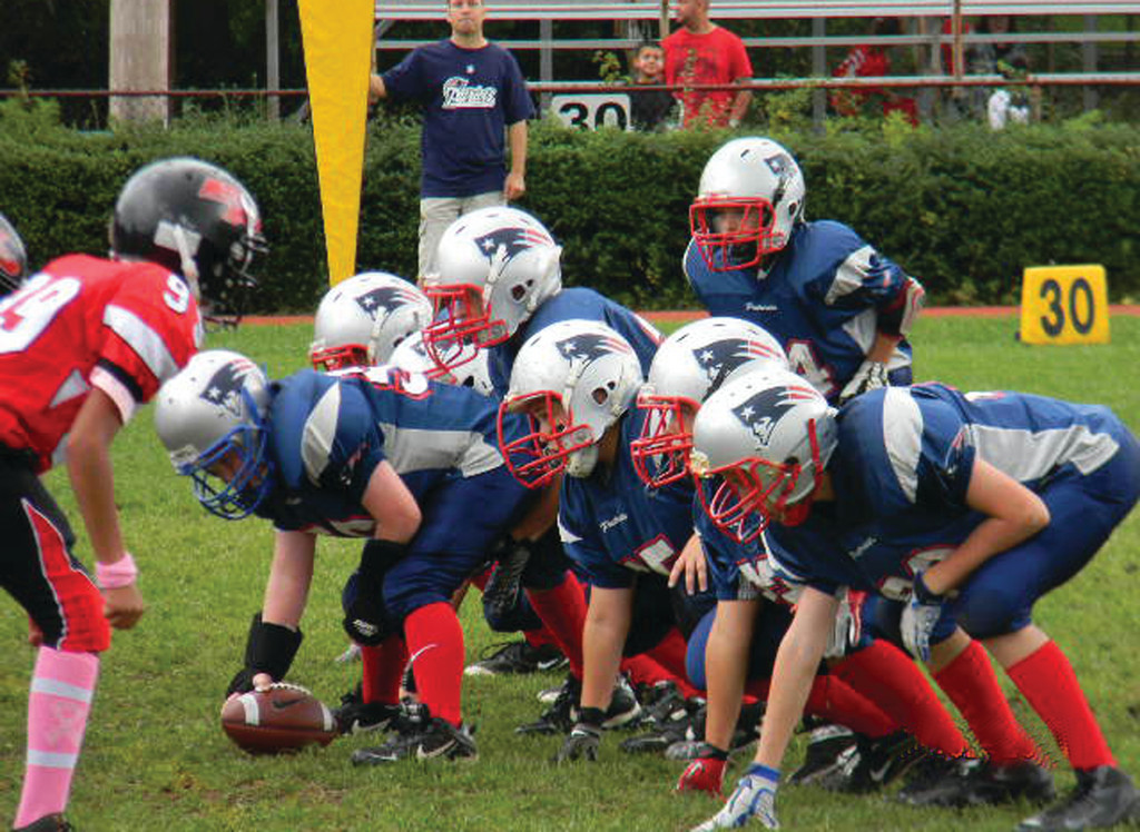 READY TO GO: The Warwick PAL Pee Wee team gets set for the snap in Sunday's game.