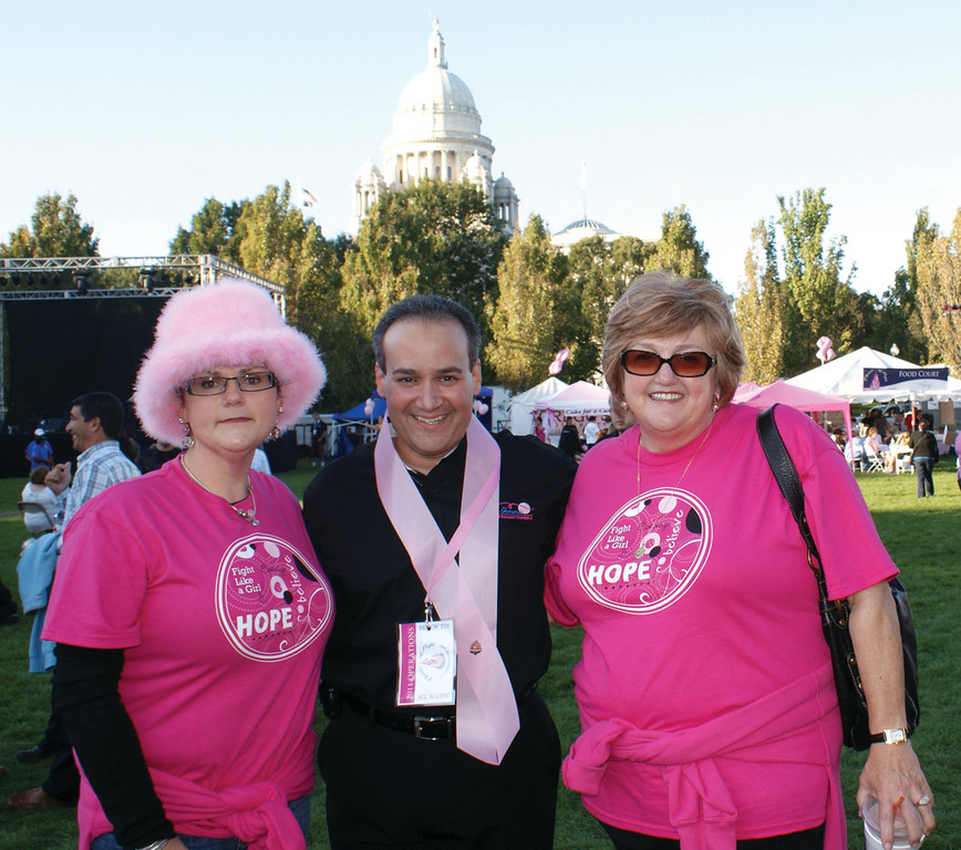 MAKING NEW FRIENDS: Pictured is Anthony Gemma of the Gloria Gemma Breast Cancer Resource Foundation and Gina Vigorito (survivor) and her mother Donna Vigorito of Cranston.