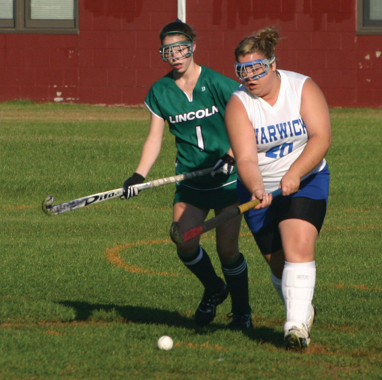 Vets' Tina DiSanto tries to clear the ball out of the defensive zone during Thursday's game against Lincoln.
