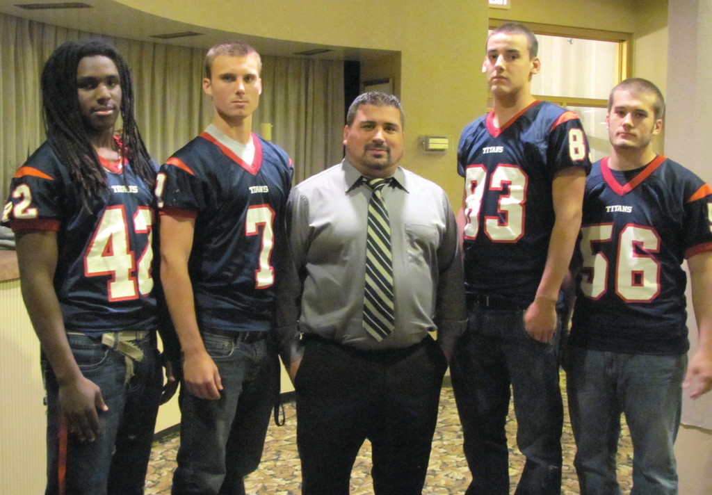 Toll Gate High�s head football coach Matt Mancuso (center) is flanked by the Titans captain�s corps that includes, from left: Derick Durand, Mitchell Howkins, Nicholas Carr and Stephen Haley.
