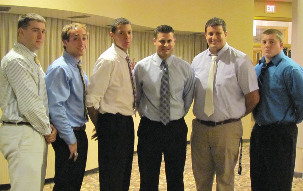 Bishop Hendricken High�s football Hawks were represented at the Providence Gridiron Club�s annual �Captain�s Night� by, from left: Andrew Breting, Ryan Brannigan, Laionel Cintron, Head Coach Keith Croft, Maximillan Heintzelman and Michael Clapp.