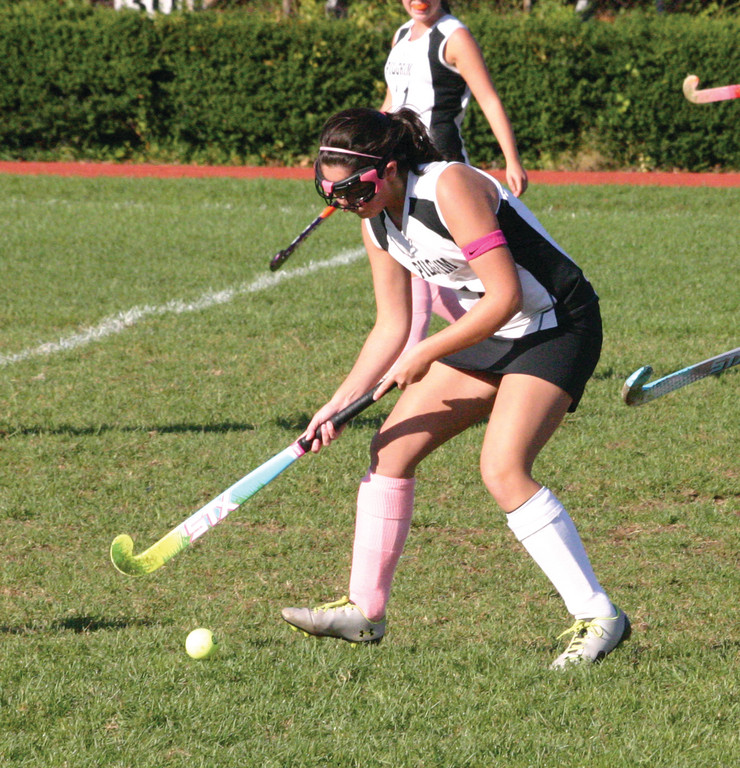 Pilgrim's Julianna Mollo pushes the ball up the field.