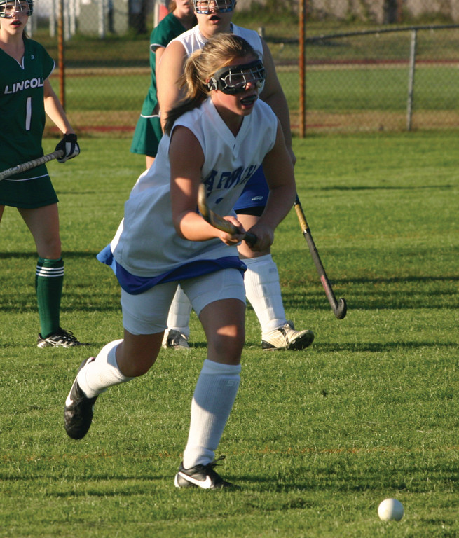 Naomi Franzen hustles after a loose ball up the right side.