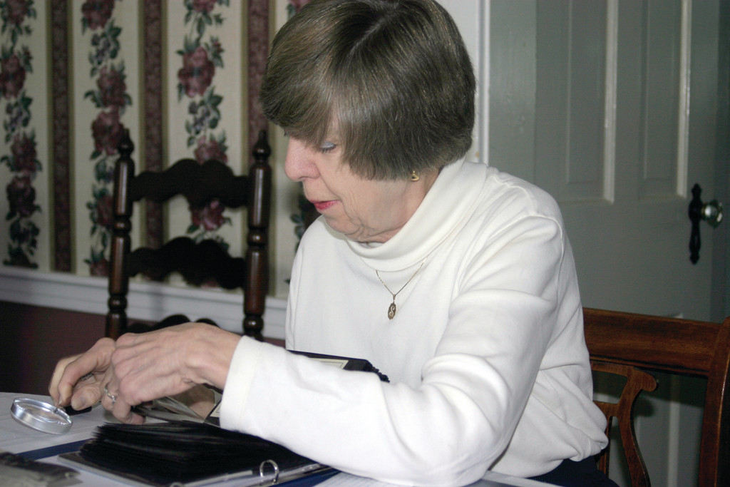 MEMORIES: Former Pontiac resident Shirley Nordquist reviews pictures from the old neighborhood, when Pontiac was a Swedish-American enclave.