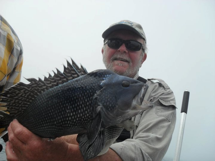 Chris Bellavance with a black sea bass caught off Block Island on Priority Too Charters out of Point Judith.