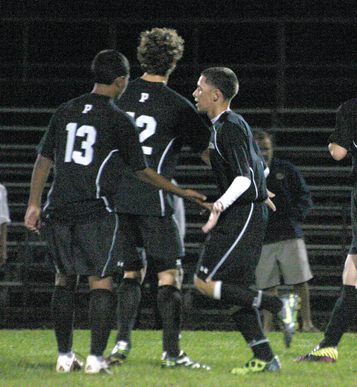 Pilgrim's Luis Pimental celebrates with Devon Crespin (13) and Ian Giuttari following his second goal in Tuesday's game against Warwick Vets. The Pats won 4-0.