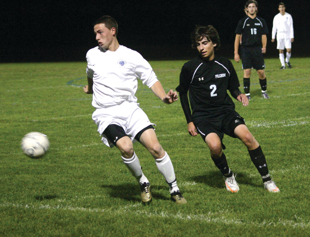Vets' Dylan Robert, left, battles with Pilgrim's Austin DeSantis for possession on Tuesday.