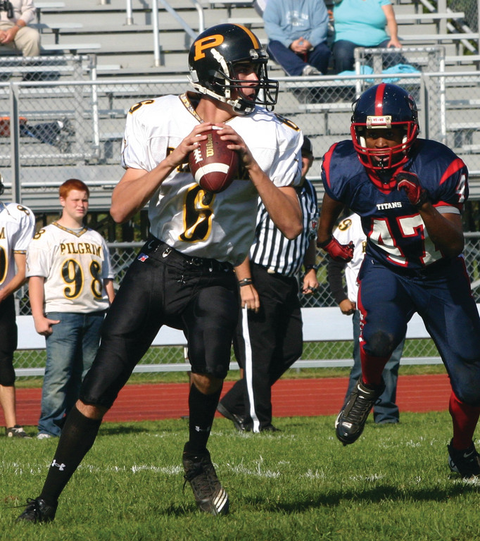 Pilgrim's Lee Verrier drops back to pass in last week;s win over Toll Gate. The win mean's Pilgrim is in the thick of the Division II playoff playoff race.