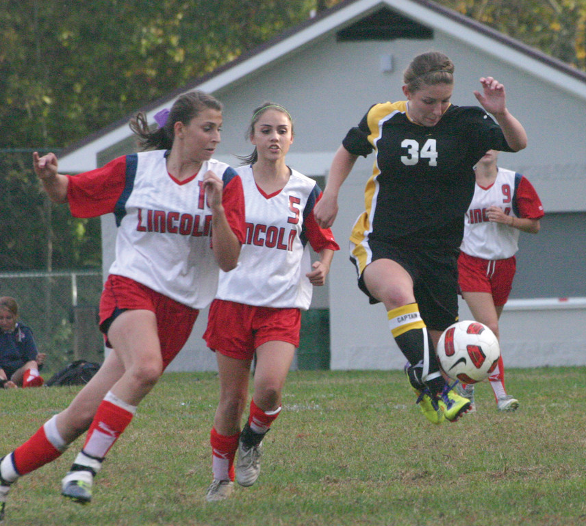 Pilgrim's Heather Wolfenden jumps to settle a pass in Tuesday's game against Lincoln.