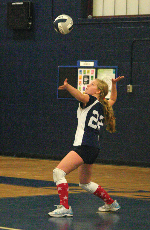 Jamie Lavoie takes a serve on Tuesday.