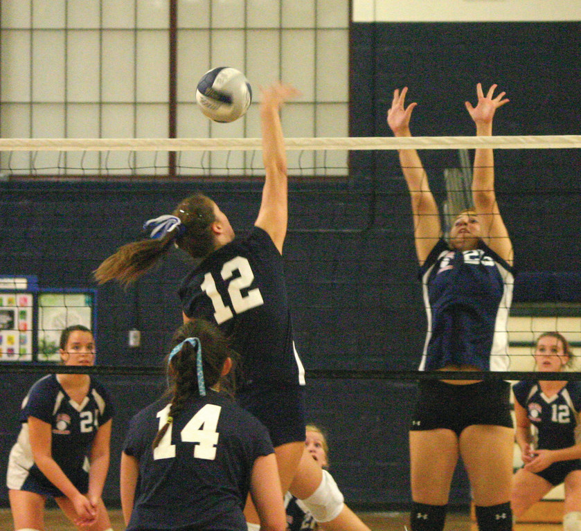 Laura Kanzanjian rises for a block.