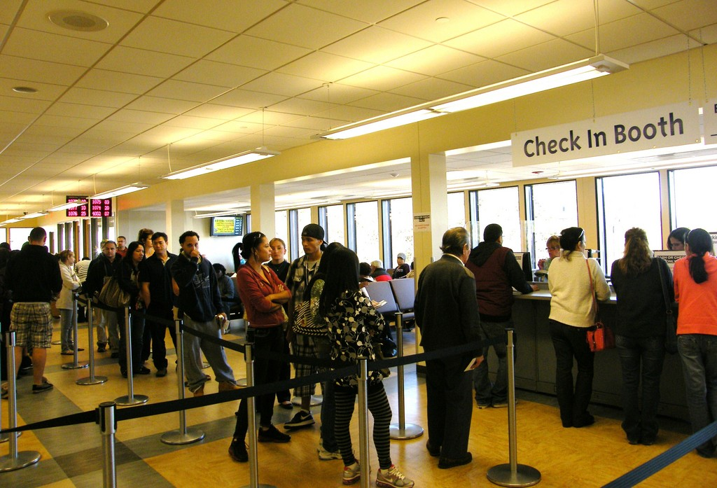 WAITING: Visitors to the DMV wait in line at the new check-in booth to receive their numbers. The booth has helped to decrease wait times, said Governor's DMV Resource team member Debbie Rich.