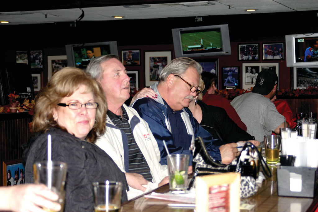 PREVENTIVE MENTAL HYGIENE: Nancy Marley, Jim Armstrong (front left) and other players set Saturday night aside for trivial pursuits at the All Stars Bar and Grill on Airport Road. Nancy says it helps keep her mind sharp. Similar contests are held on slow nights in bars throughout southeastern New England.