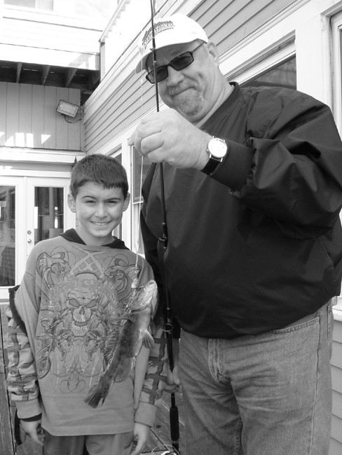 Greg Anthony, East Providence and Charlie Wood, Barrington with one of the tautog they caught on Greg's first ever saltwater fishing outing. Greg (nine years old) caught three tautog during the first 45 minutes of fishing before the bite shut off.
