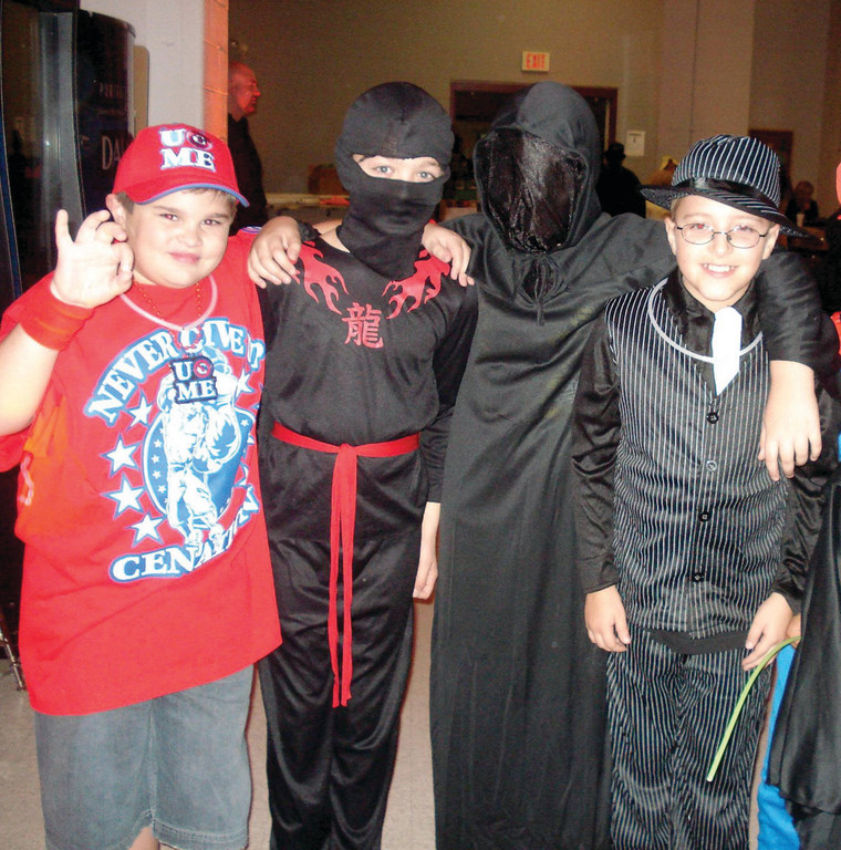 BOYS CLUB: Sean Myrick, Brendan Prestage, Andrew Levine and Christopher Kerfoot get a practice run in for next week's trick-or-treating.