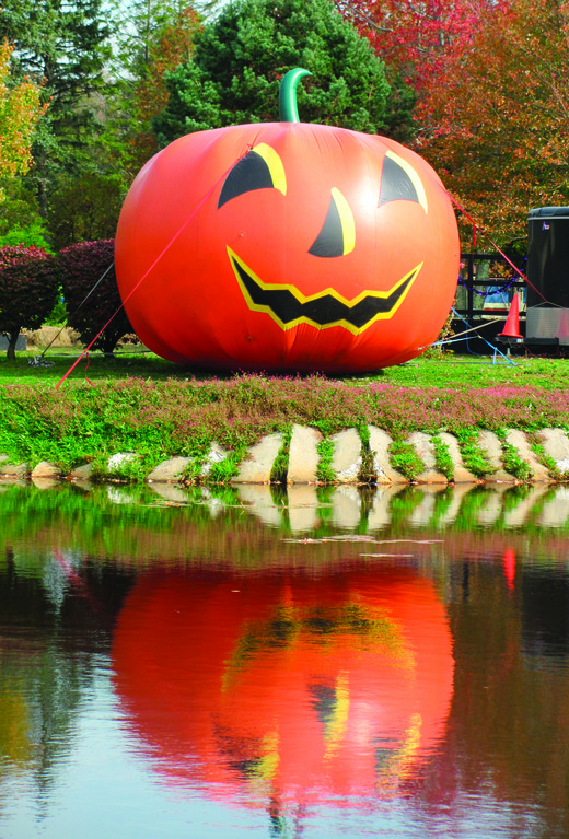 REFLECTIONS: This is the huge inflatable pumpkin that sits on the island inside Johnston War Memorial park. It was a focal point of last weekend's Spooky Walk and will also be on display tomorrow night and Saturday evening when the Halloween haunting continues.