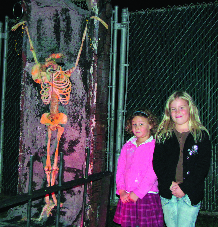 READY FOR SCARES: Jaycee Gonya and Kali Mae Gonya were among the first youngsters to visit the scary creatures waiting in the pool shed.