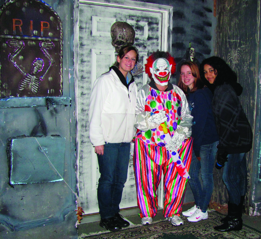 "NOT FOR KIDS: ""The Clown"" gets a visit from these Spooky Walk volunteers who served as ushers for the Haunted House set up on the tennis court, created by Jimmy Rotondo."