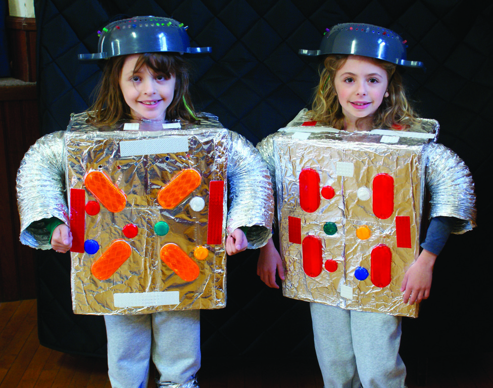 TWIN ROBOTS: Fraternal twins Julia and Mia Wasilewski, age 8, arrive in robost costumes made by their parents.